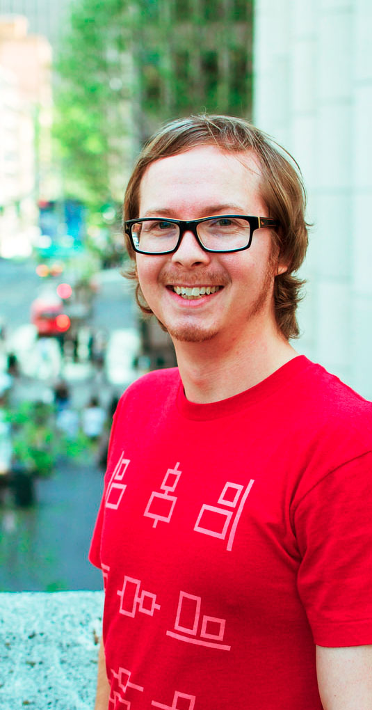 Photo of User Experience Designer, Adam Ruf, wearing a nerdy designer t-shirt